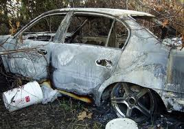 William Tanner's Burned Car, in Which the Remains of Henry Glover were located