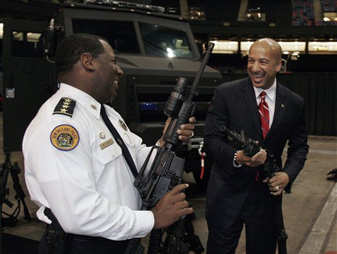 Look, it's the Mayor of Hurricane Katrina, Ray Nagin, showing off the New Orleans Police Department's new guns! He's setting a good example for the city he cannot control. [AP Photo]